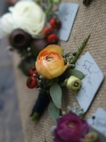 Oreonta house woodstock boutoniere for father of the bride with orange ranunculus red rosehipsa nd sage green eucaliptus