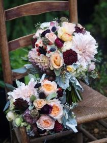 Oreonta house woodstock wedding bridal bouquet with garden rose dahlia scabiosa seed pods, eucaliptus and wildflowers on vintage wicker chair rosehip social
