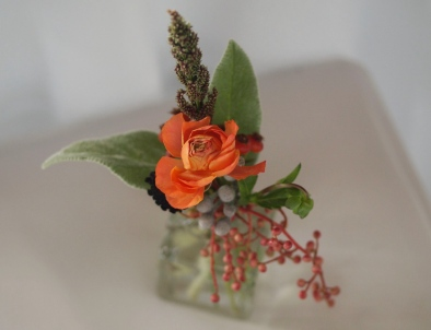 Oreonta house woodstock wedding bud vase with orange ranunculous, lambs ears, grey brunia, red berries and red rosehips and wildflowers rosehip social rosehip floral