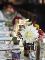 Centerpieces in gold accented wine bottle